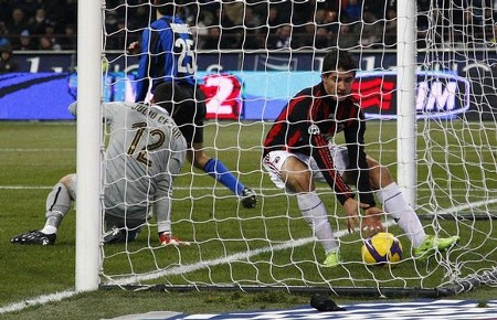 AC Milan's Pato (R) retrieves the ball after scoring against Inter Milan during their Italian Serie A soccer match at the San Siro stadium in Milan February 15, 2009. (REUTERS)