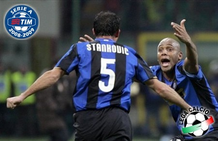 Inter Milan midfielder Dejan Stankovic, left, celebrates with teammate Maicon after scoring, during the Serie A soccer match between Inter Milan and AC Milan and at the San Siro stadium in Milan, Italy, Sunday, Feb. 15, 2009. (AP Photo by Carlo Baroncini)