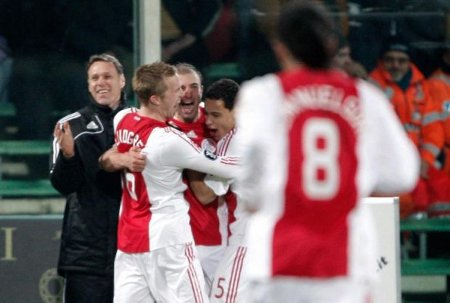 Ajax Amsterdam's Kennedy Bakircioglu celebrates with his team mates and his coach Marco Van Basten (L) after scoring against Fiorentina during their UEFA Cup soccer match at the A. Franchi stadium in Florence February 19, 2009