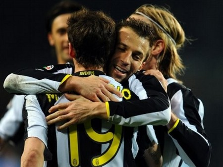 Juventus midfielder Claudio Marchisio, foreground back to camera, celebrates with teammates Alessandro Del Piero, facing camera midground, Nicola Legrottaglie, far background, and Christian Poulsen, at right midground during the Italian Serie A soccer match between Juventus and Napoli, at the Olympic Stadium in Turin, Italy, Saturday, Feb. 28, 2009. (AP Photo)