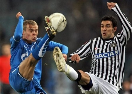Udinese's Fabio Quagliarella, right, and Zenit St. Petersburg's Aleksandr Anyukov fight for the ball during a UEFA Cup, Round of 16, first-leg soccer match between Udinese and Zenit St. Petersburg, in Udine, Italy, Thursday, March 12, 2009. (AP Photo)