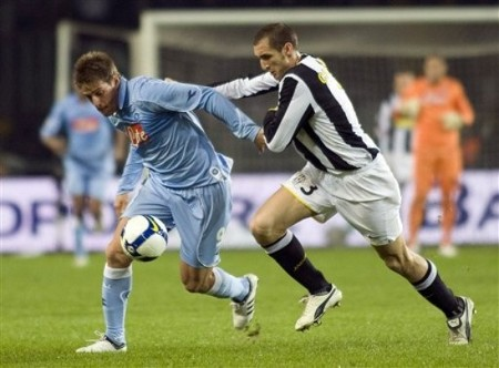 Juventus defender Giorgio Chiellini, right, presses Napoli's German Denis of Argentina, during the Italian Serie A soccer match between Juventus and Napoli at the Olympic Stadium in Turin, Italy, Saturday, Feb. 28, 2009. (AP Photo)