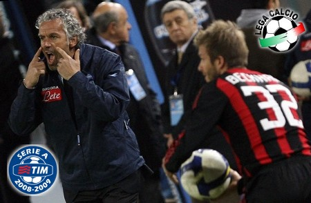 Napoli's coach Roberto Donadoni (L) shouts orders at his team beside AC Milan's David Beckham during their Italian Serie A soccer match at the San Paolo stadium in Naples, March 22, 2009. (REUTERS)