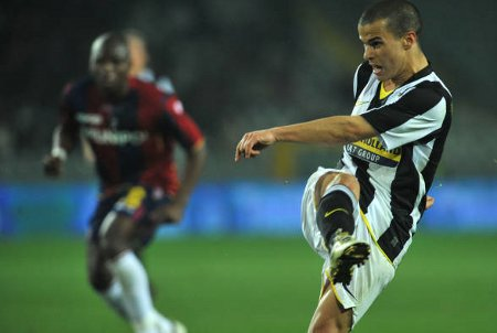 Juve's Sebastian Giovinco (R) takes a shot to score vs. Bologna.