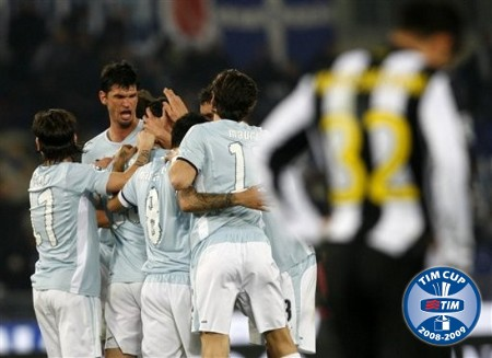Lazio forward Goran Pandev, not seen in background, is congratulated by fellow team members after scoring a goal during their first leg semifinal Italian Cup soccer match against Juventus at Rome's Olympic stadium, Tuesday, March 3, 2009. (AP Photo)