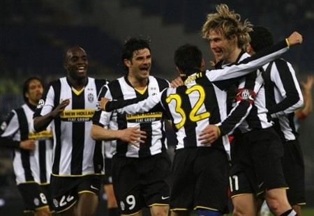 Juventus midfielder Marco Marchionni , back to the camera n.32, celebrates with teammates after scoring, during a first leg semifinal Italian Cup soccer match between Lazio and Juventus at Rome's Olympic stadium, Tuesday, March 3, 2009. From left far background, Amauri of Brazil, Mohamed Sissoko of Mali, Vincenzo Iaquinta and Pavel Nedved of the Czech Republic, at right. (AP Photo)