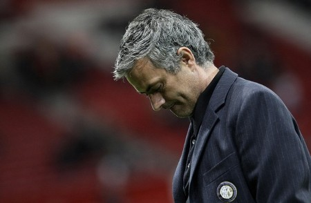 Inter Milan's coach Jose Mourinho looks at the ground before their Champions League soccer match against Manchester United in Manchester, northern England, March 11, 2009. (REUTERS)