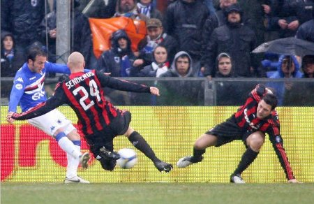 Sampdoria's Giampaolo Pazzini (L) shoots to score in front of Milan's Philippe Senderos and Daniele Bonera (R). March 1, 2009.