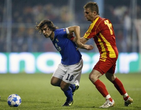 Italy's Andrea Pirlo (L) is challenged by Montenegro's Nikola Pekovic during their 2010 World Cup qualifying soccer match in Podgorica March 28, 2009. (REUTERS)
