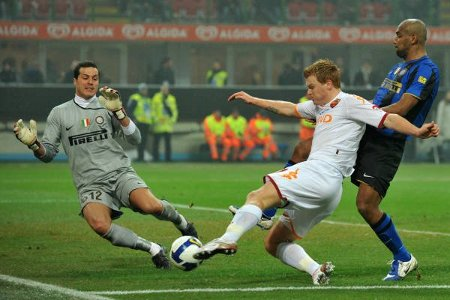 Jon Arne Riise makes it 2-0 for Roma.