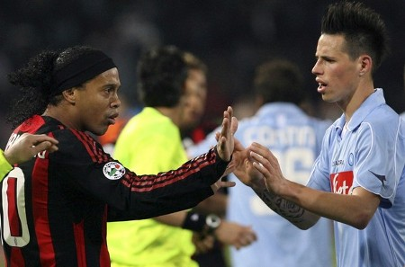 Napoli's Marek Hamsik (R) argues with AC Milan's Ronaldinho during their Italian Serie A soccer match at the San Paolo stadium in Naples, March 22, 2009. (REUTERS)