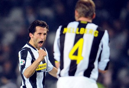 Juventus' Hasan Salihamidzic of Bosnia, left, reacts with fellow team member Olof Mellberg of Sweden after scoring a goal during the Serie A soccer match against Bologna, in Turin's Olympic Stadium, Italy, Saturday, March 14, 2009. (AP Photo)