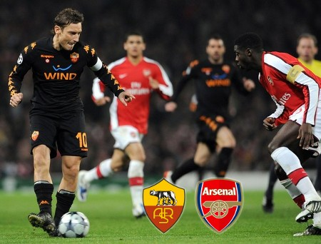 AS Roma's forward Francesco Totti (L) challanges with Arsenal's Ivorian defender Kolo Toure (R) during their Champions League first knockout round football match, at The Emirates stadium in London on February 24, 2009. (AFP/Getty Images)