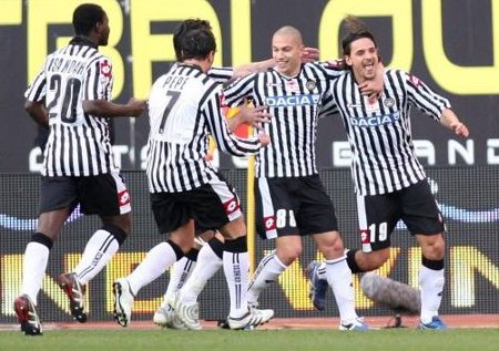 Udinese players celebrate the first goal