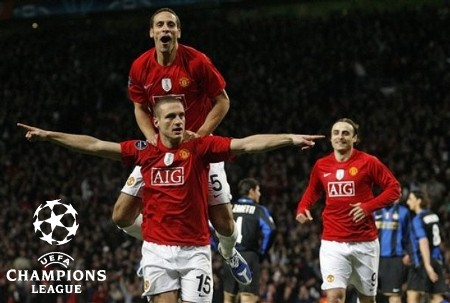 Manchester United's Nemanja Vidic, bottom left, reacts with teammate Rio Ferdinand, top left, after scoring a goal during their Champions League second round, second leg, soccer match against Inter Milan at Old Trafford Stadium, Manchester, England, Wednesday, March 11, 2009. (AP Photo)