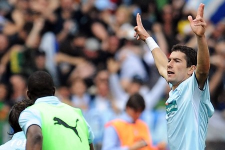 Lazio's Serbian defender Aleksandar Kolarov celebrates after scoring during the Italian serie A football match AS Roma against Lazio on April 11, 2009 at Olympic stadium in Rome. Lazio won 4-2. (GETTY IMAGES)