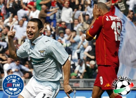 Lazio's Mauro Zarate (L) celebrates after scoring as AS Roma's Julio Baptista reacts during their Serie A soccer match at the Olympic stadium in Rome April 11, 2009. (REUTERS)