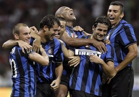 Inter Milan's Serbian midfielder Dejan Stankovic, second from left, reacts after scoring their fourth goal with from left to right, Dutch midfielder Wesley Sneijder, Argentine defender Walter Samuel, Brazilian defender Maicon, Romanian defender Cristian Chivu and Brazilian defender Lucio, during their Serie A soccer match against AC Milan at the San Siro stadium in Milan, Italy, Saturday, Aug. 29, 2009. Inter won 4-0. (AP Photo)